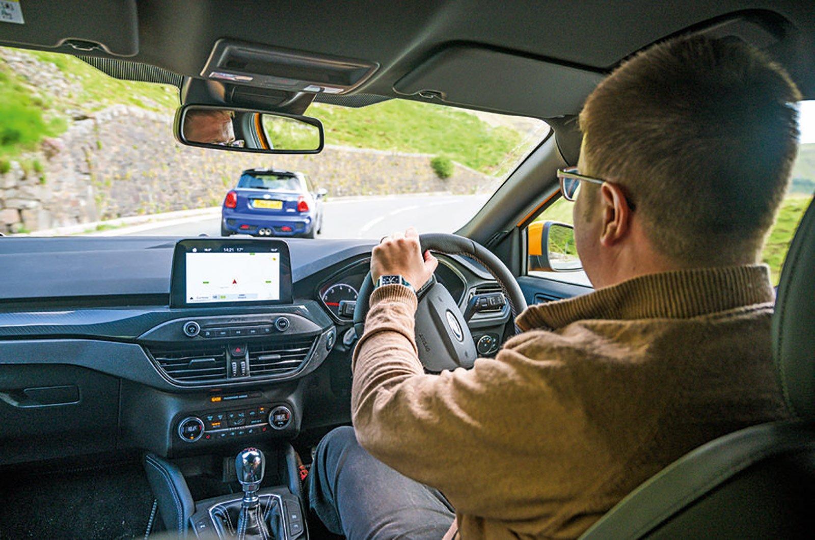 Over-the-shoulder shot of man driving car