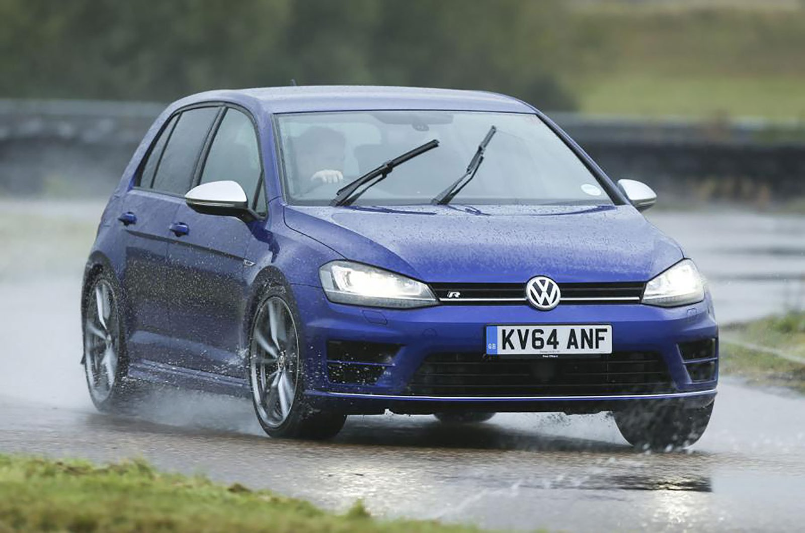 VW Golf R driving in the wet