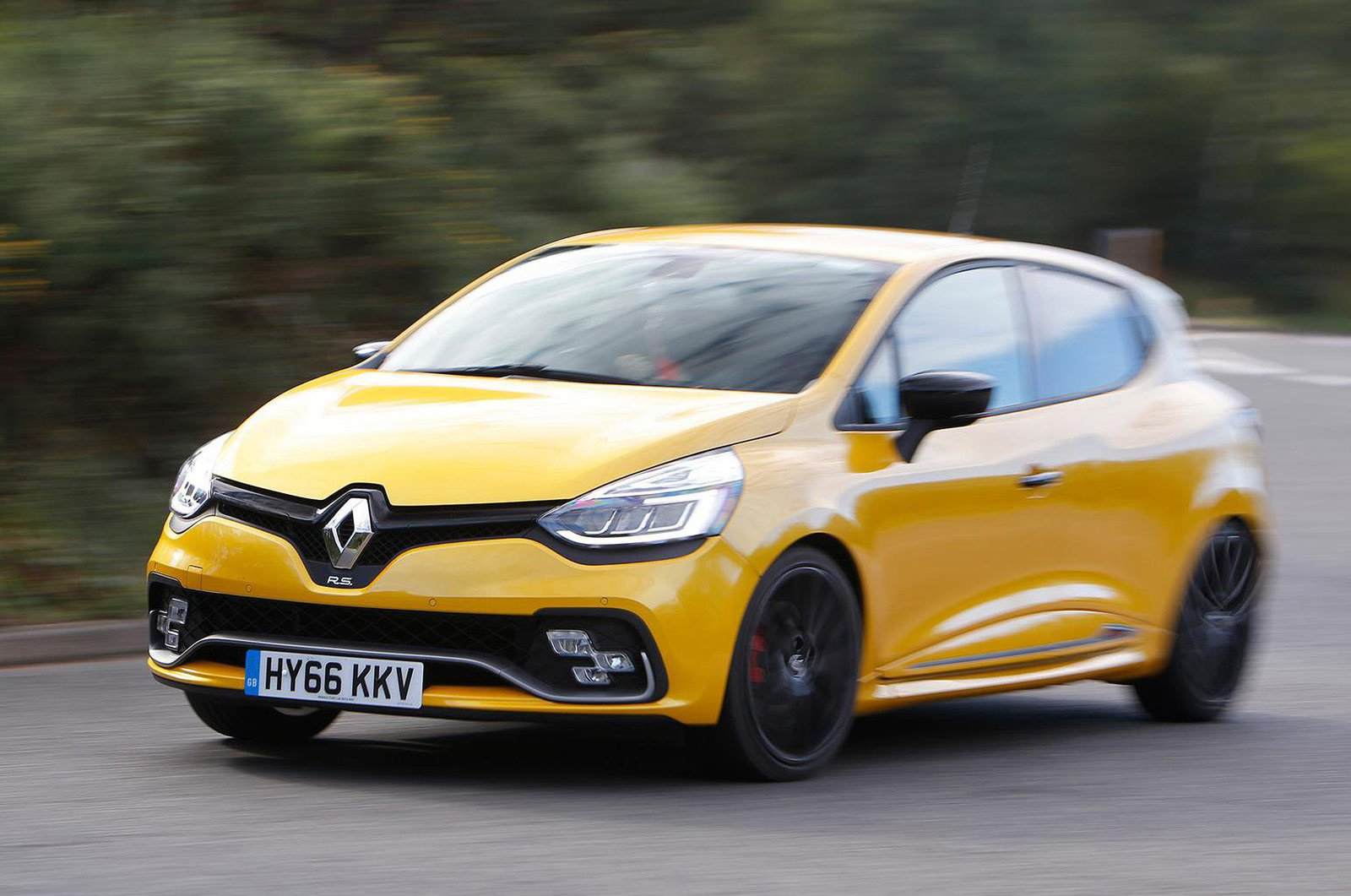 Renault Clio travelling fast round corner