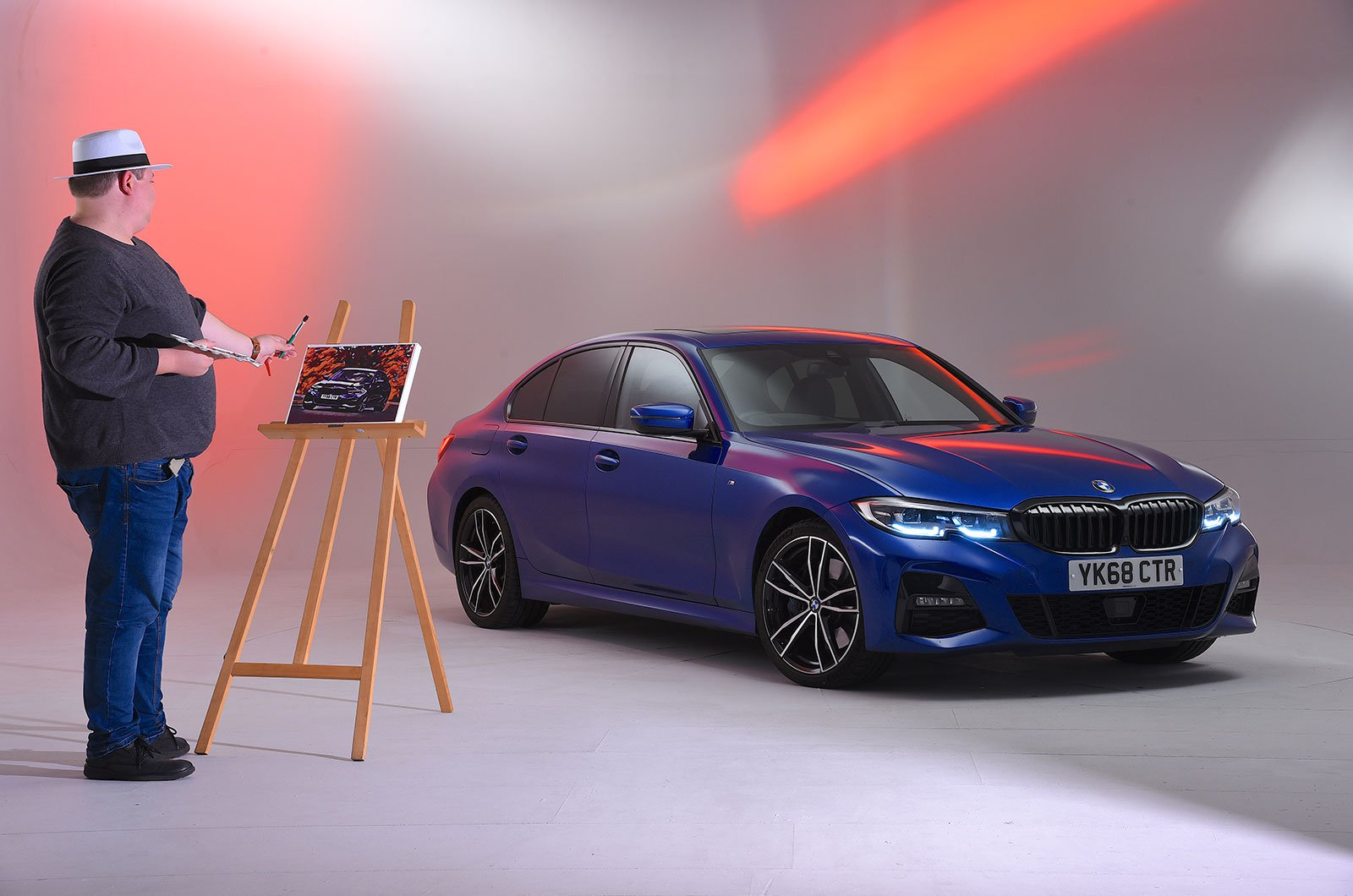 BMW 3 Series being painted in a studio