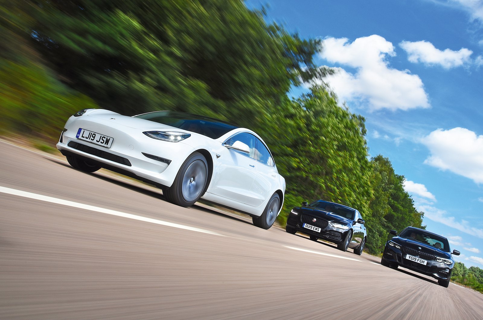 Tesla Model 3 driving with BMW 3 Series and Jaguar XE