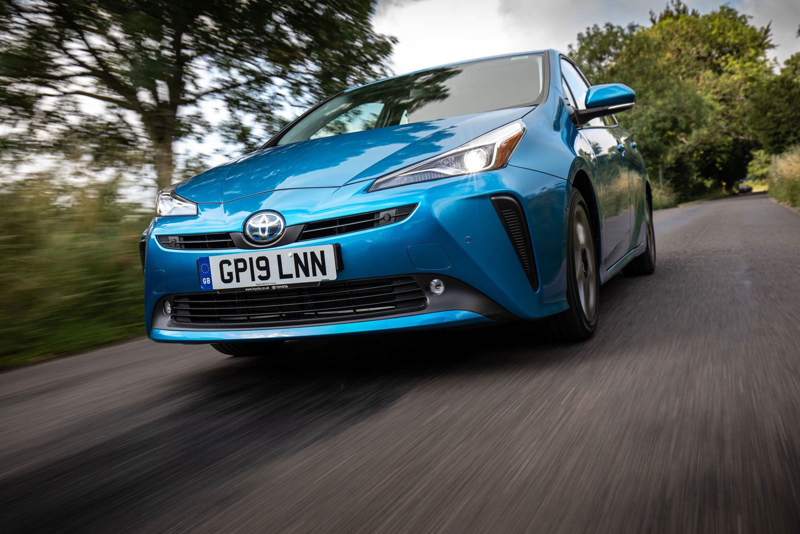 2019 toyota prius awd-i blue driving front