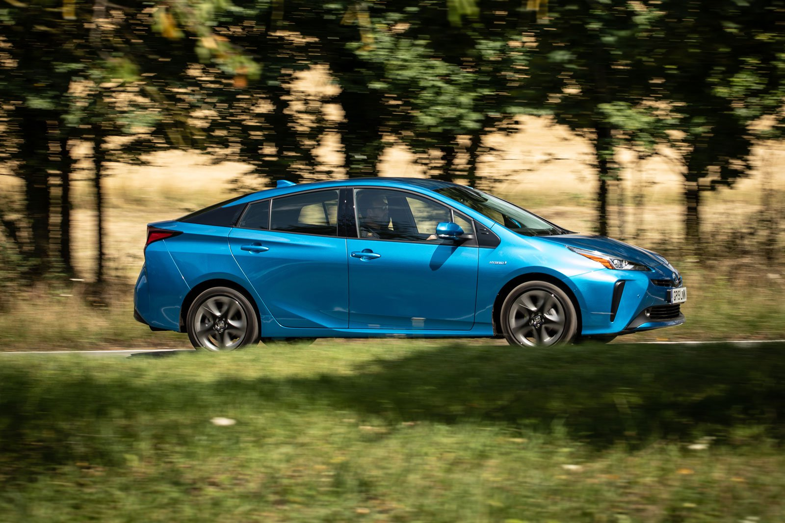 2019 toyota prius awd-i blue driving side