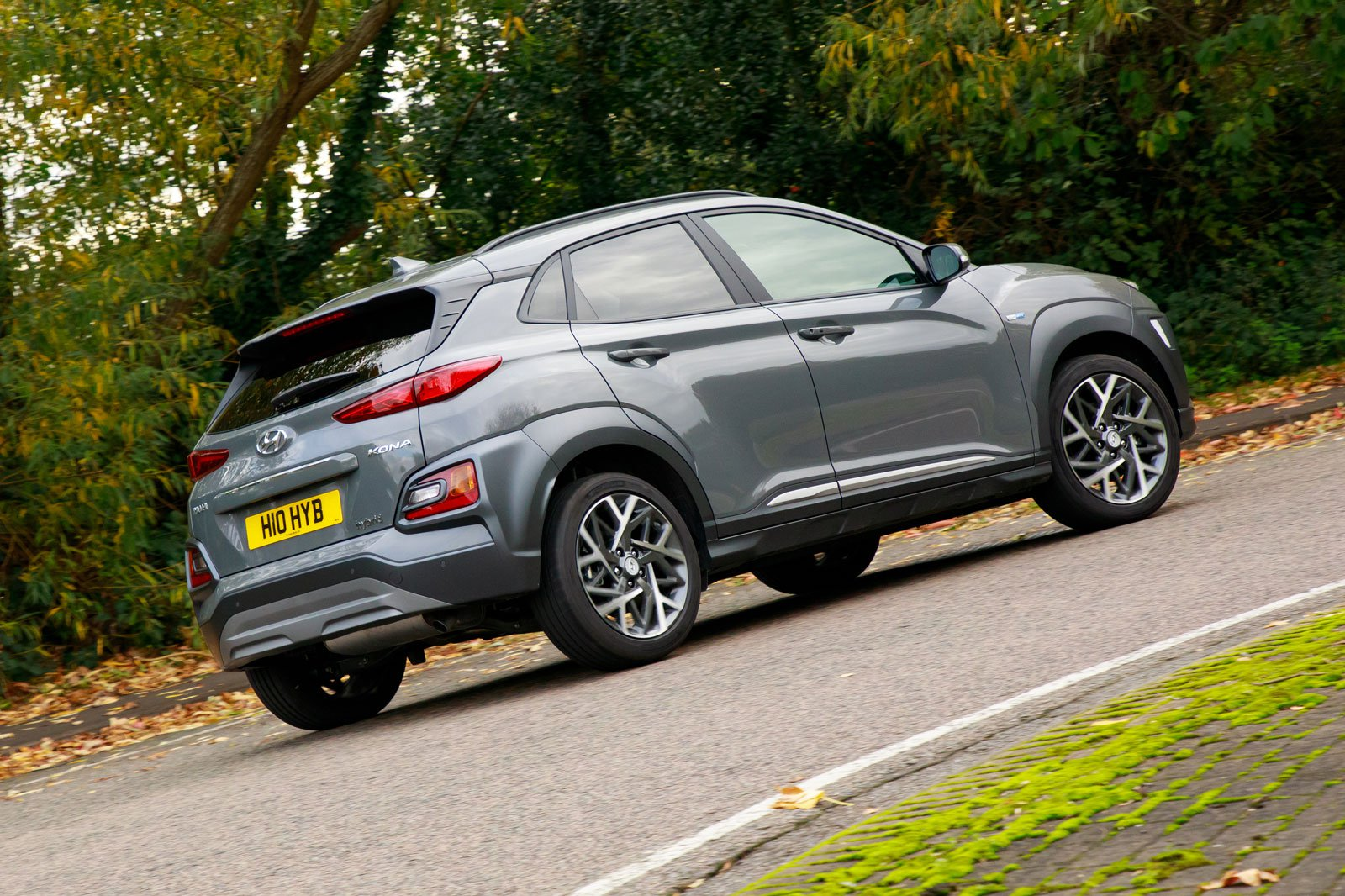 2019 hyundai kona hybrid gray driving rear cornering
