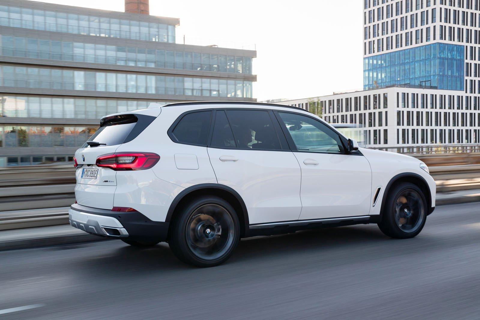 BMW X5 xDrive45e PHEV 2019 LHD rear right tracking