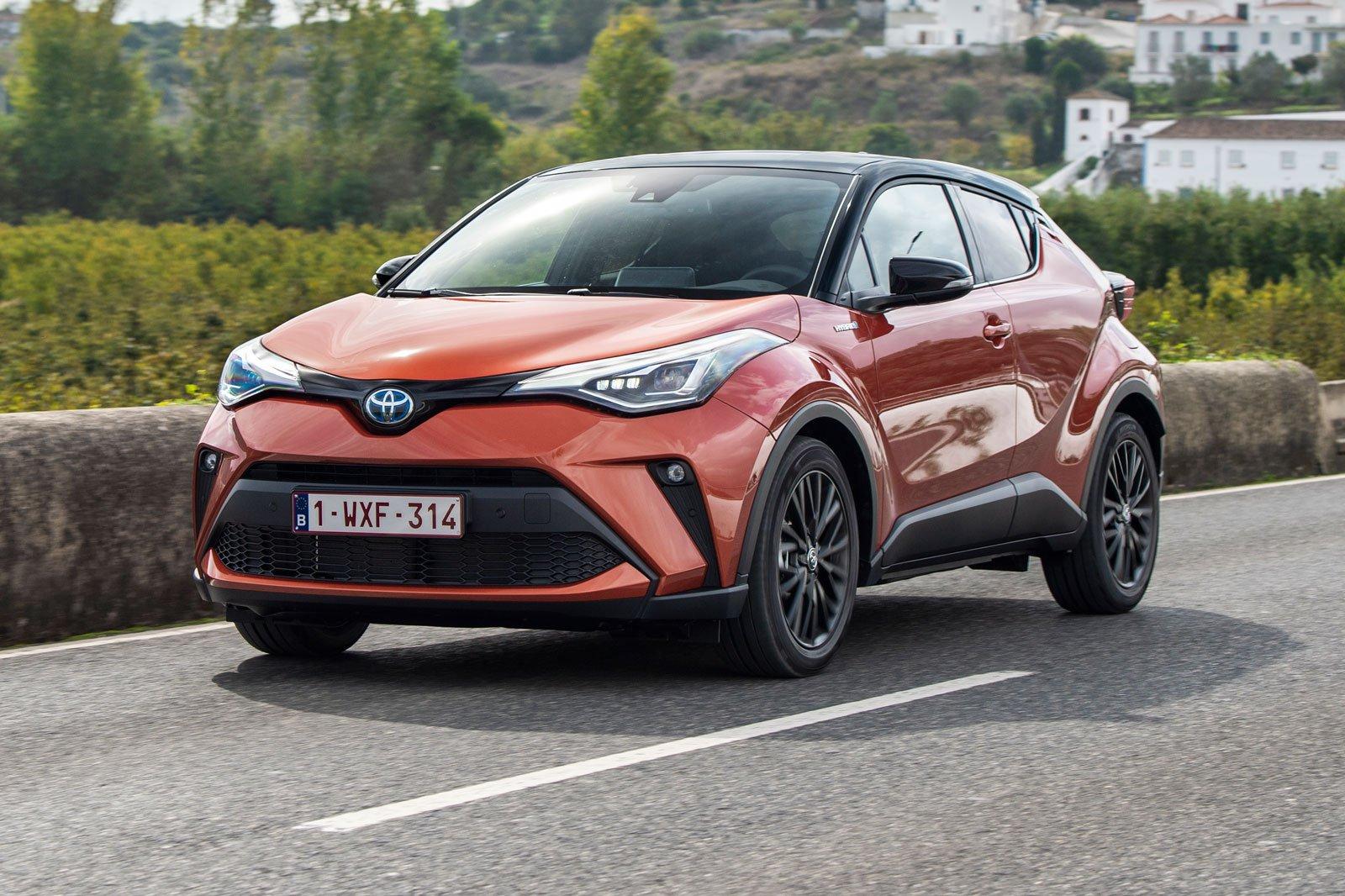 2020 toyota c-hr orange driving front