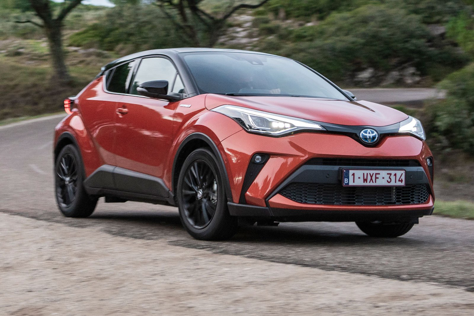 2020 toyota c-hr orange driving front cornering
