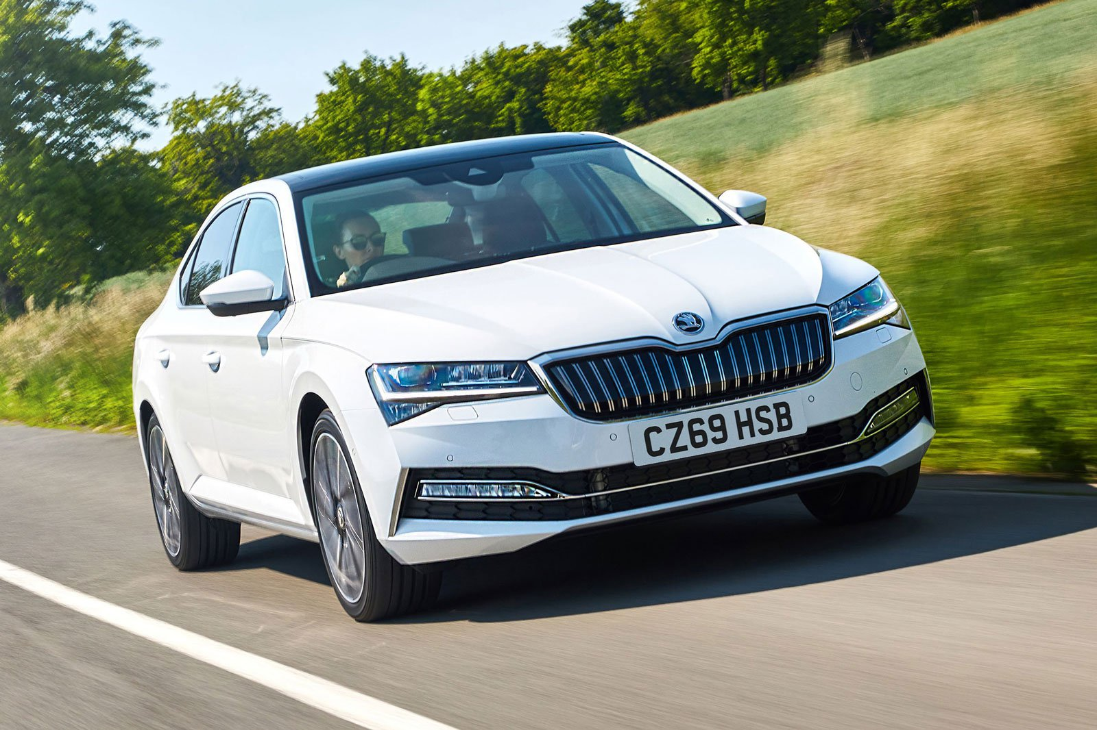 2019 skoda superb iv white driving front