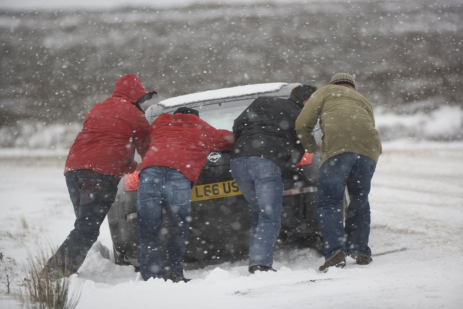 Nissan being pushed in snow