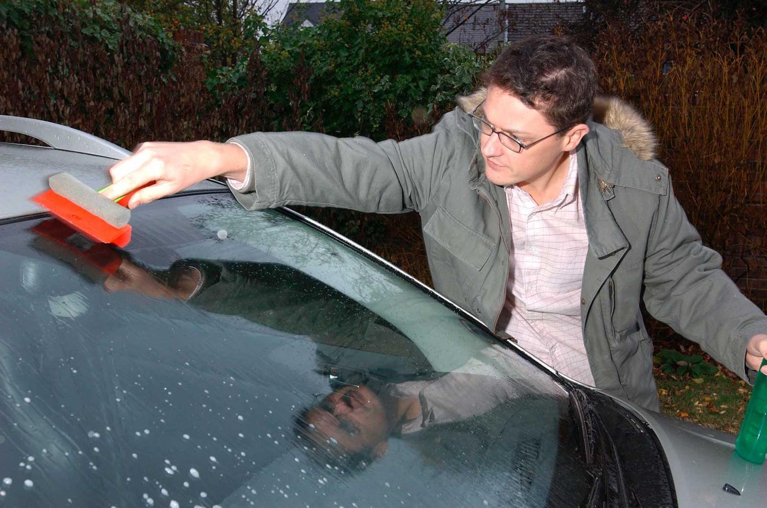 De-icer and a scraper on windscreen