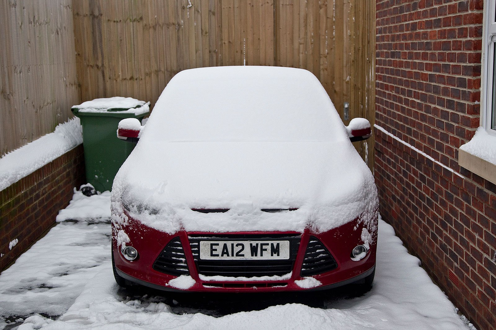 Ford Focus covered in snow