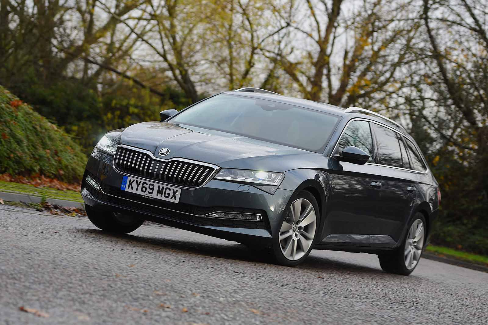 Skoda Superb Estate 2019 wide left cornering RHD