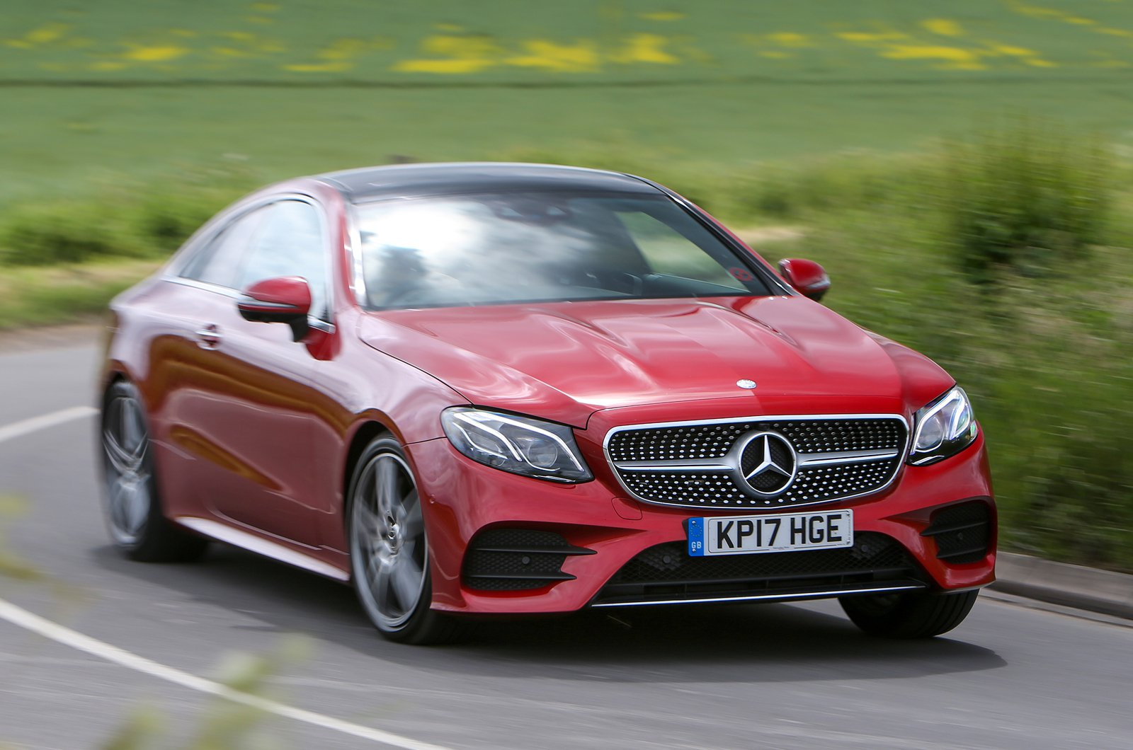 Mercedes E-Class Coupe front cornering -red