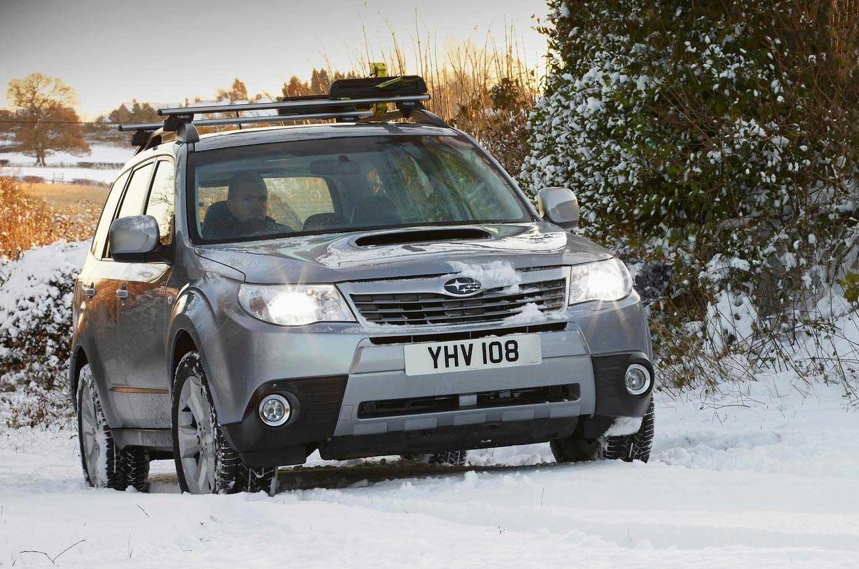 Subaru driving in the snow