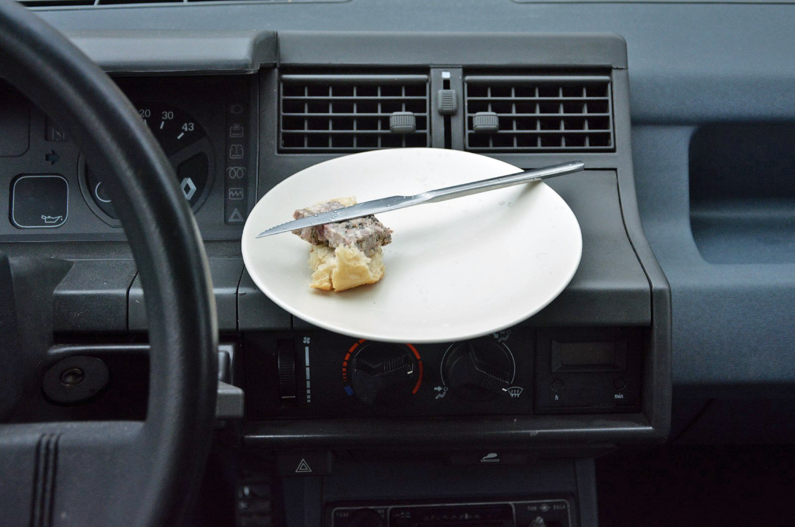 Plate of food in car cabin