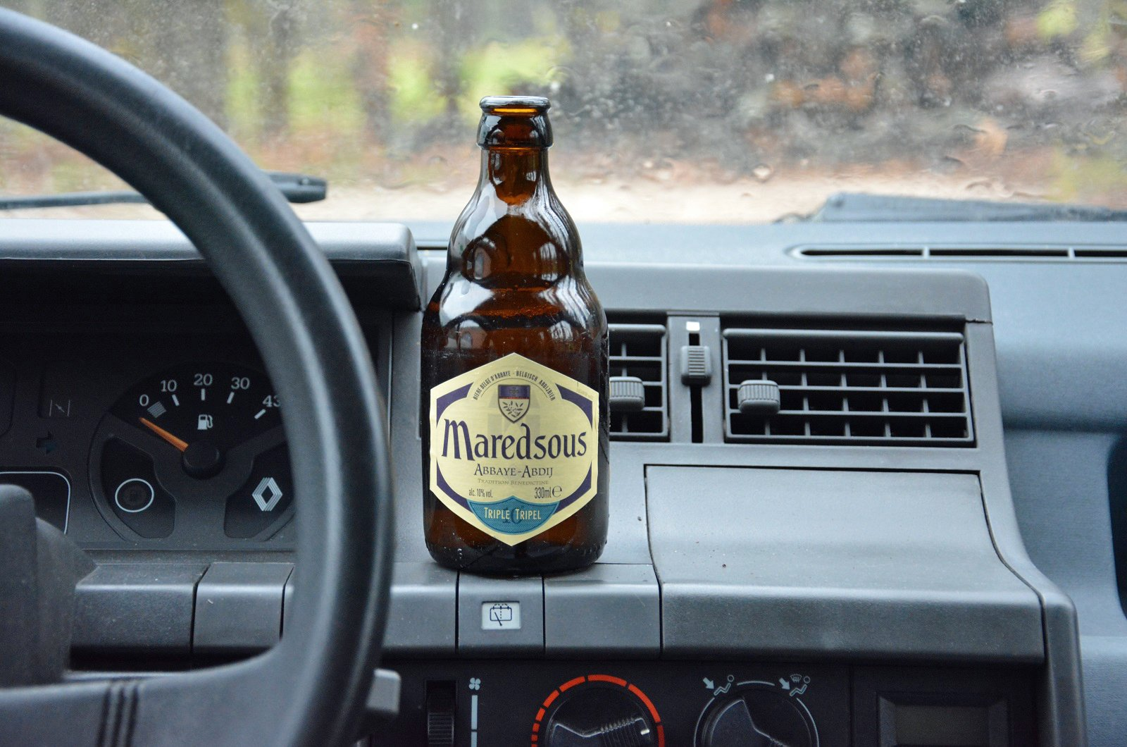 Bottle of alcohol on dashboard