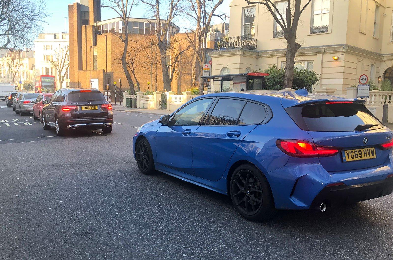 BMW 1 Series in traffic car length space