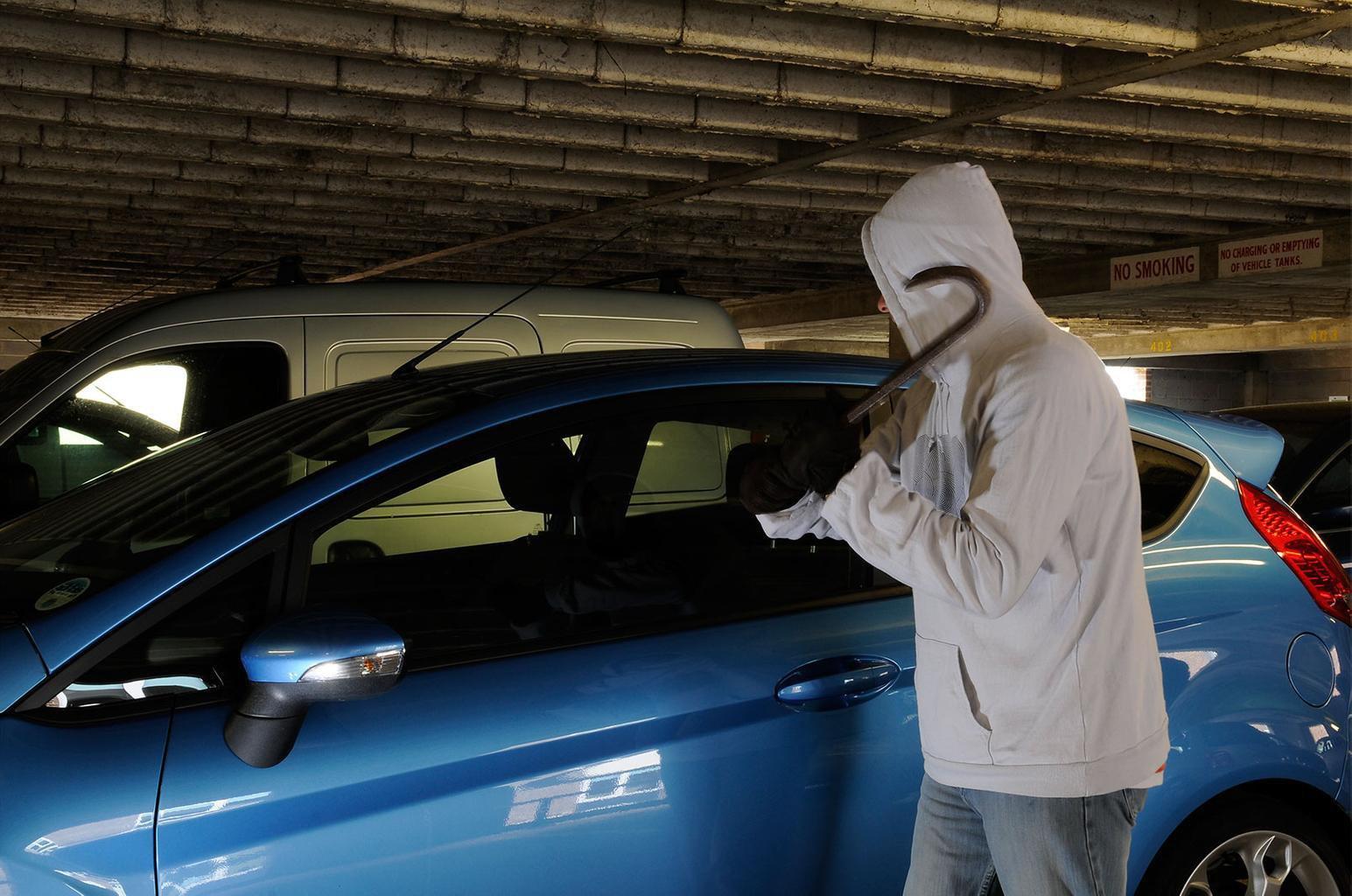 Man braking into car