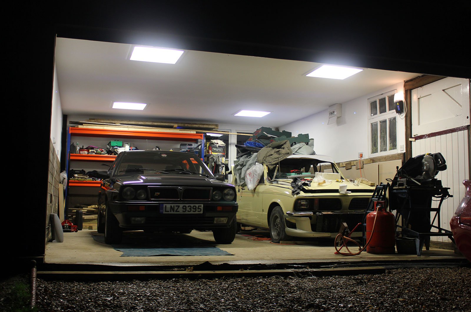 Two cars sitting in a garage
