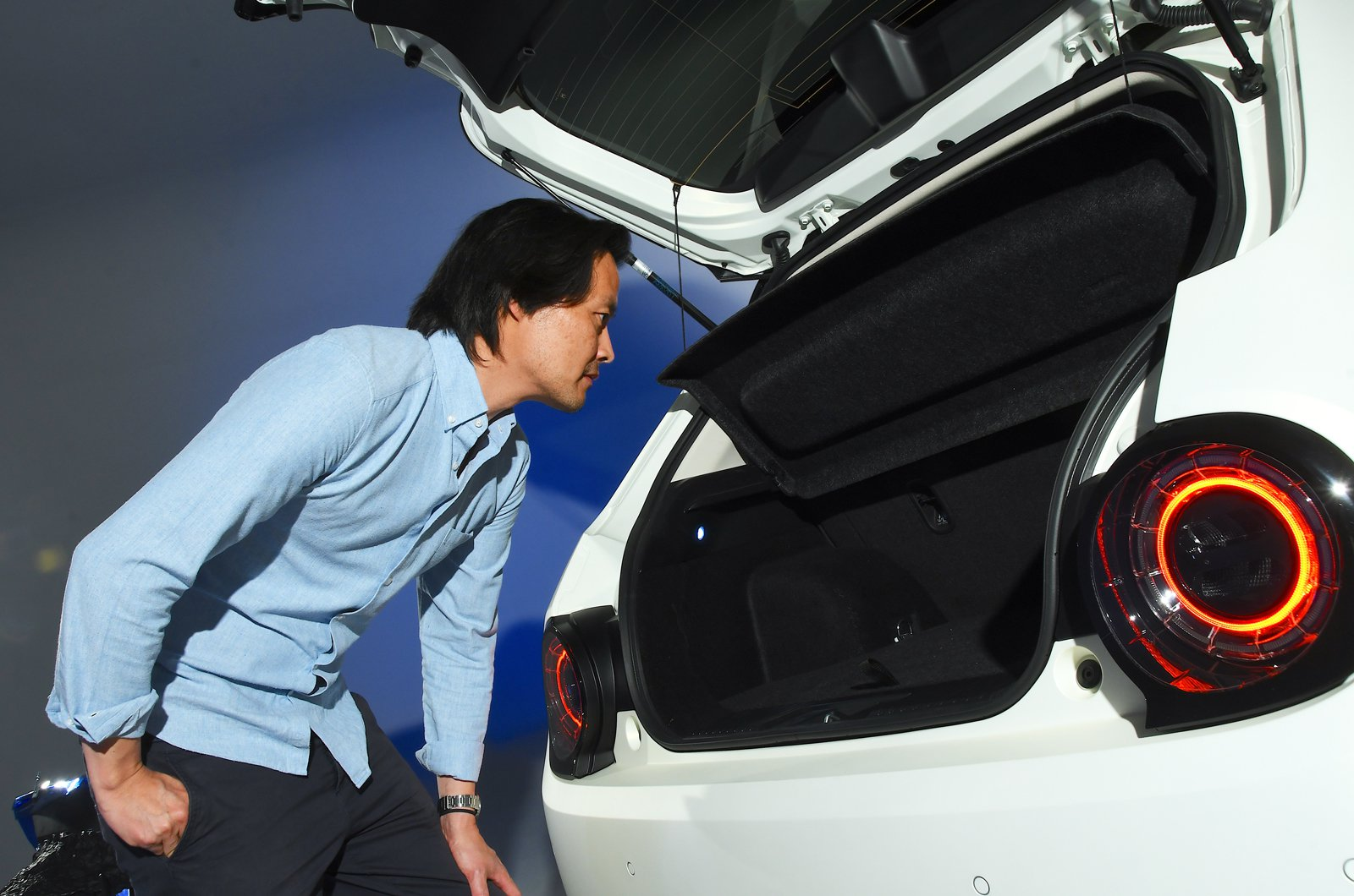 Honda E reader test team - Michael Yun looking in boot