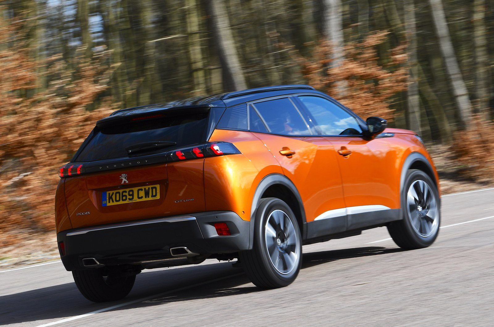 Peugeot 2008 rear panning - orange 69-plate car