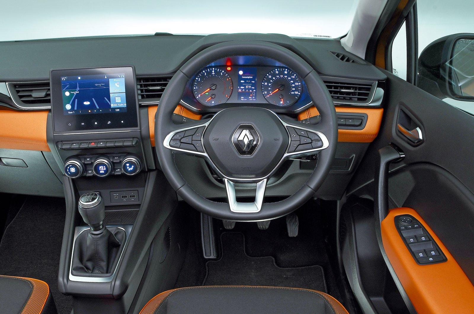 Renault Captur dashboard - orange 69-plate car