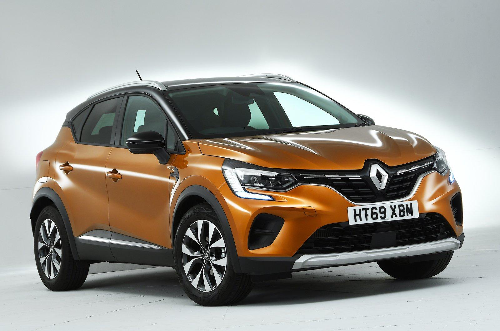 Renault Captur front studio - orange 69-plate car