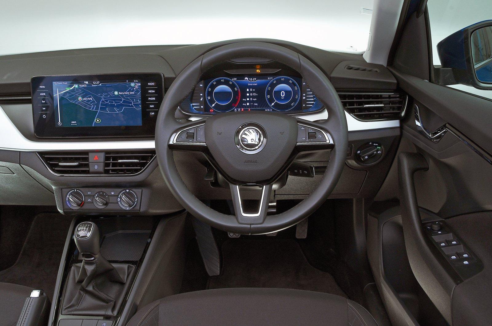 Skoda Kamiq dashboard - blue 69-plate car