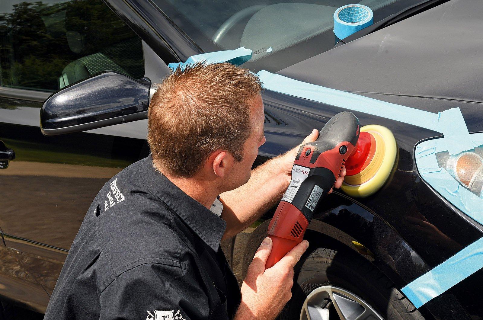 Car detailer buffing an Astra