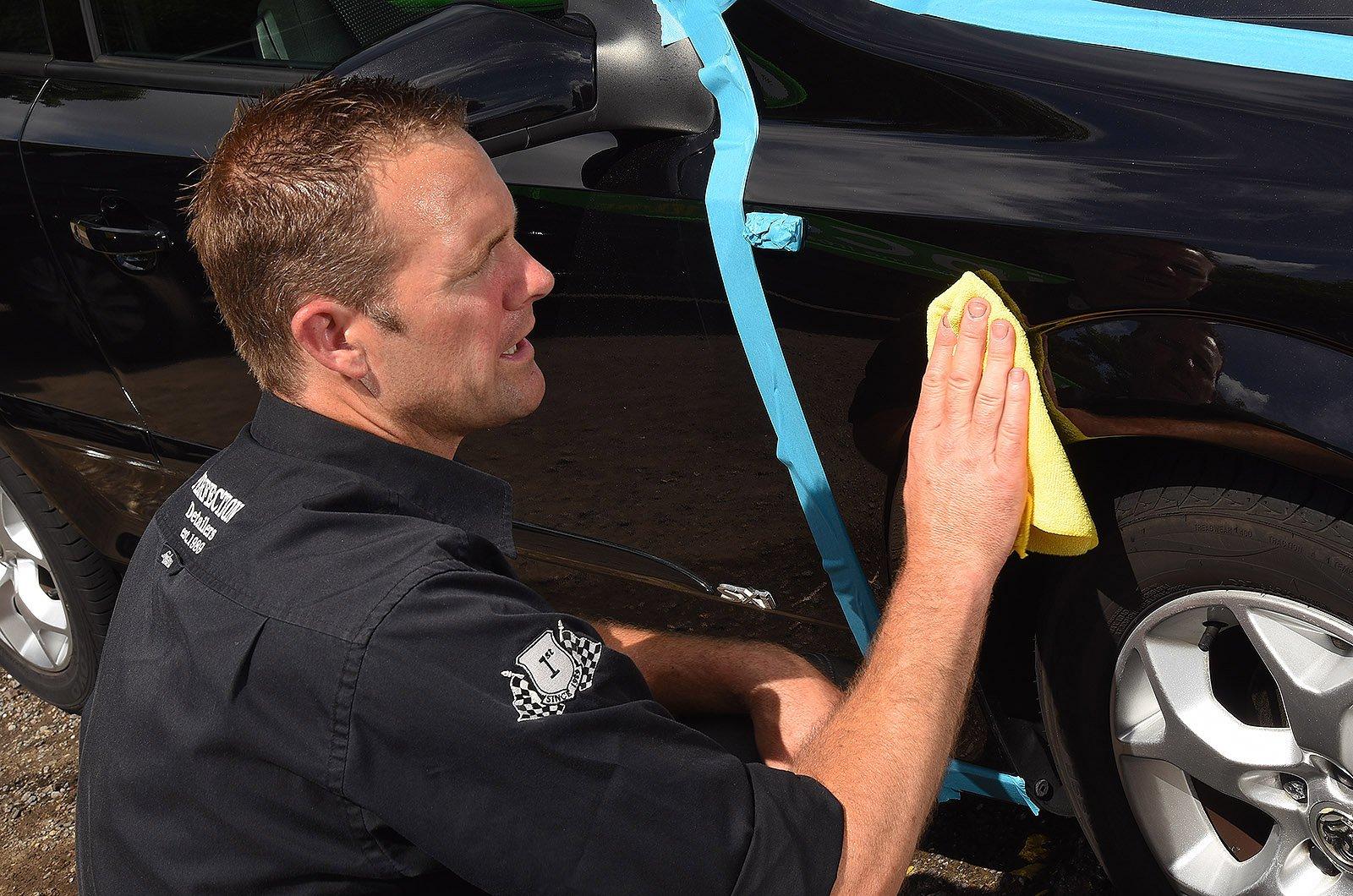 Car detailer polishing an Astra