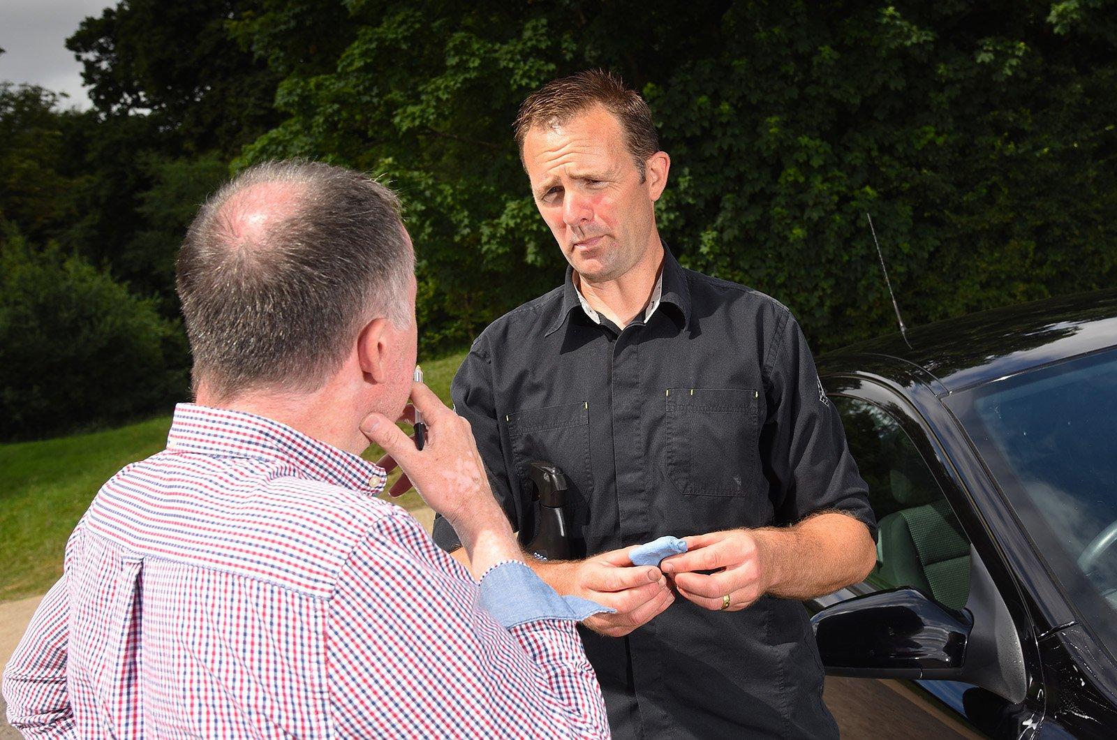 Car detailer talking to John