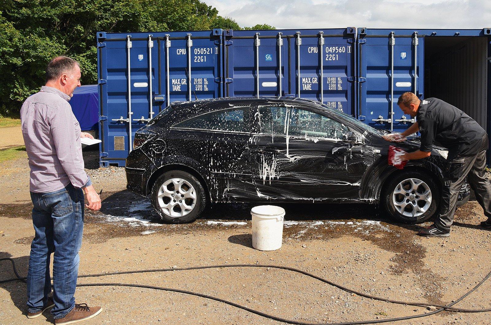 Car detailer washing an Astra