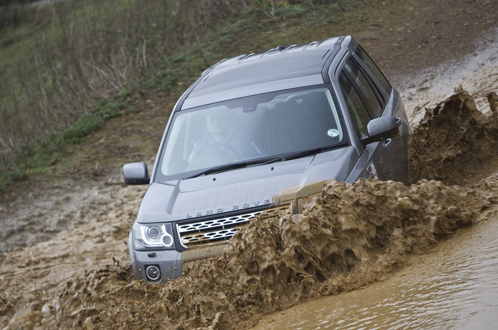 Land Rover Freelander driving through water