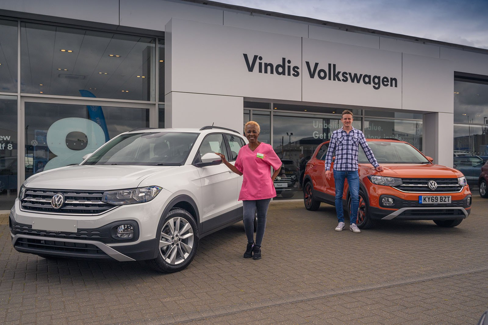Millie and her new T-Cross next to our T-Cross long termer