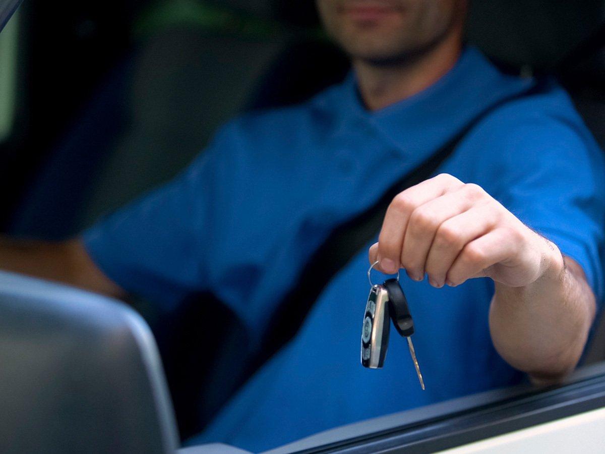 Man holding can keys