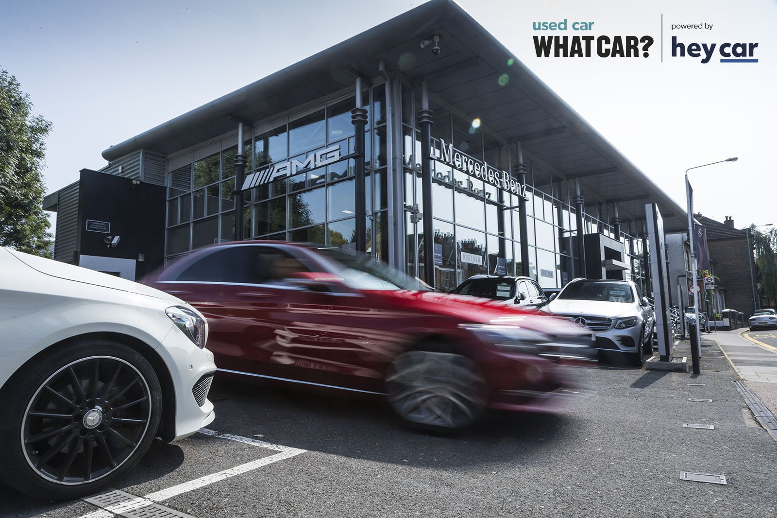 Mercedes driving off dealership forecourt