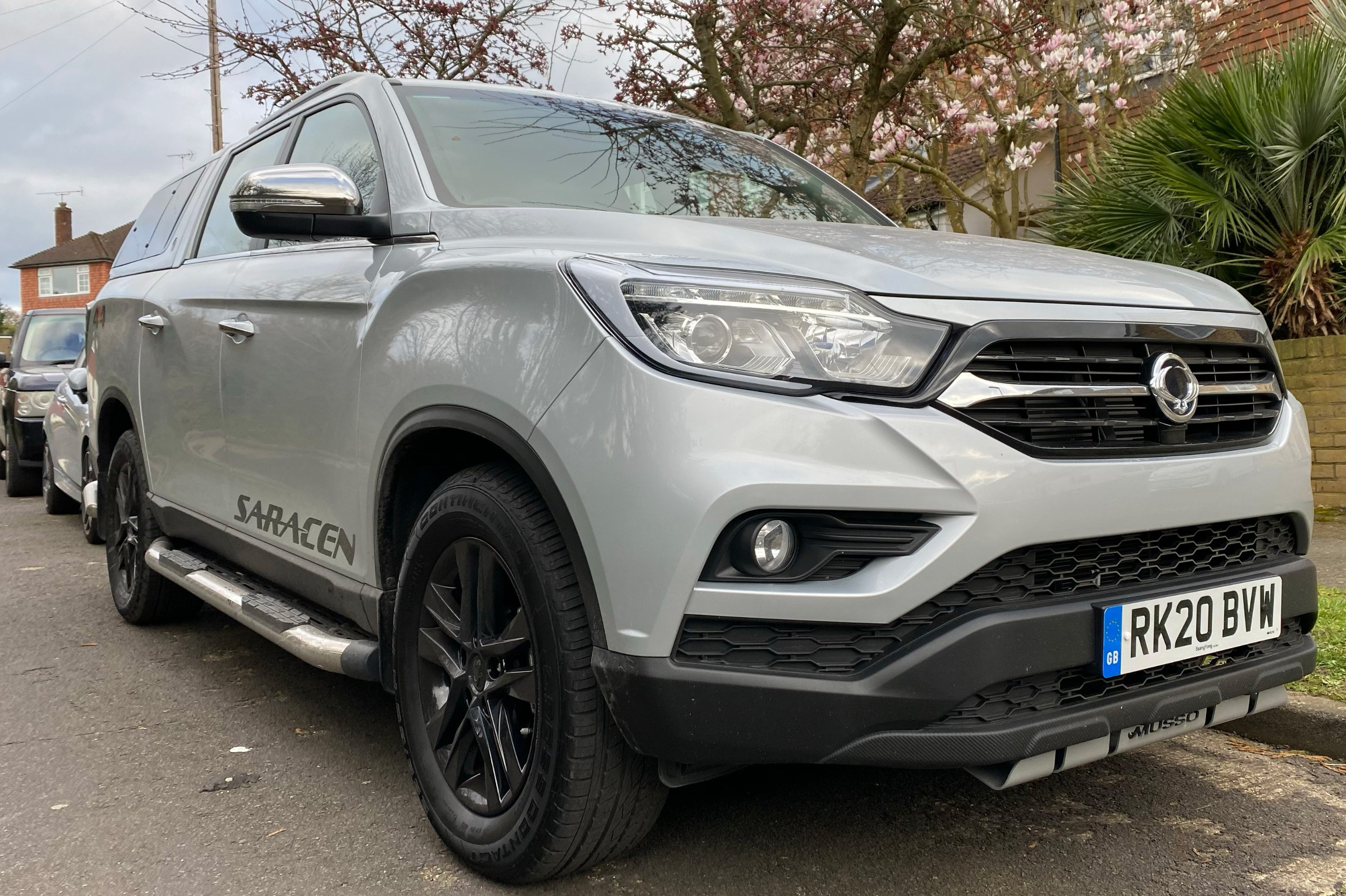 Ssangyong Musso parked on street