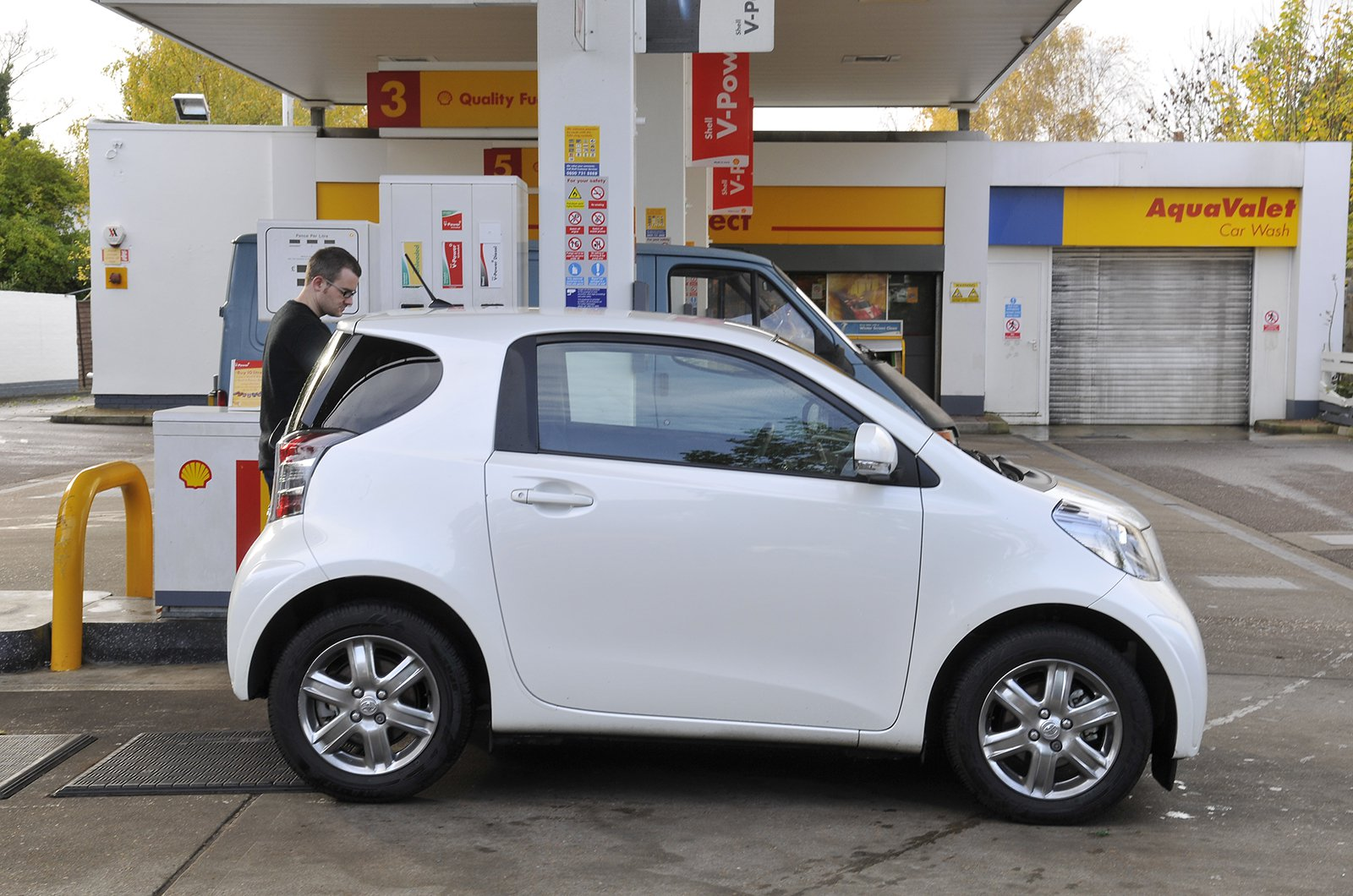 Toyota IQ by a petrol pump