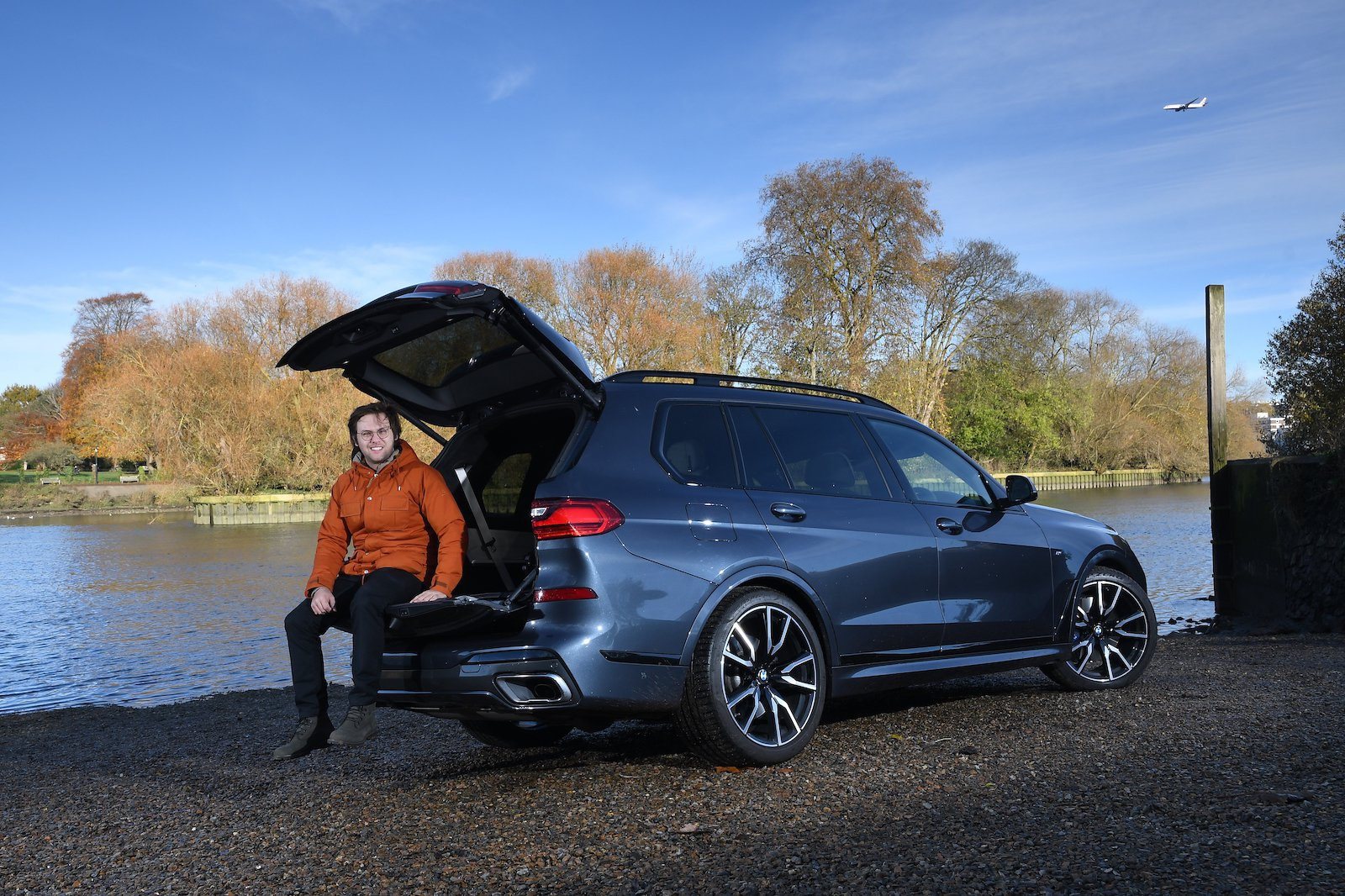 Neil Winn sitting on tailgate of long-term X7