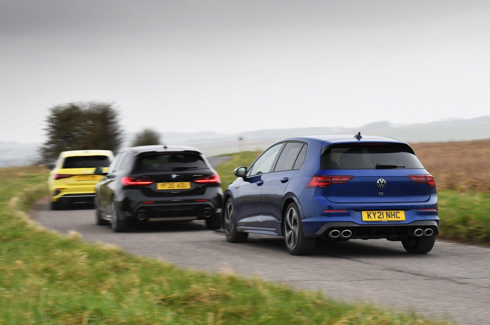 Audi S3 vs BMW M135i vs Volkswagen Golf R rears