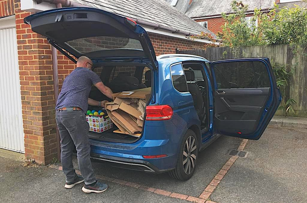 LT Volkswagen Touran with boot filled with recycling
