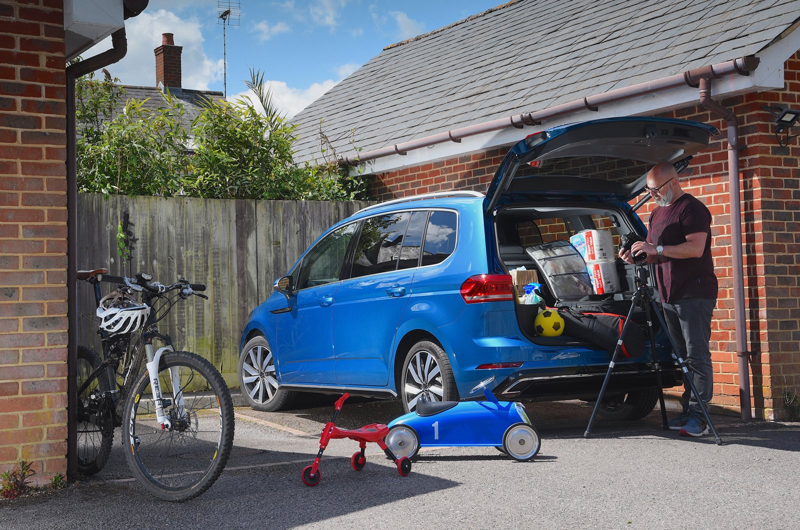 LT Volkswagen Touran with stuff you can fit in its boot