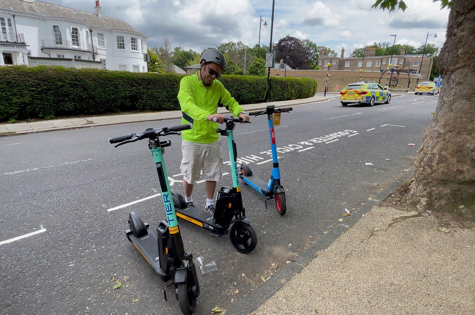 Man hiring e-scooter