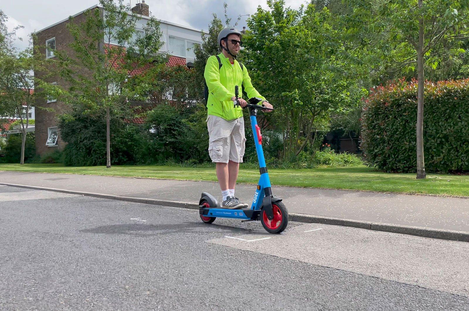 Man riding e-scooter