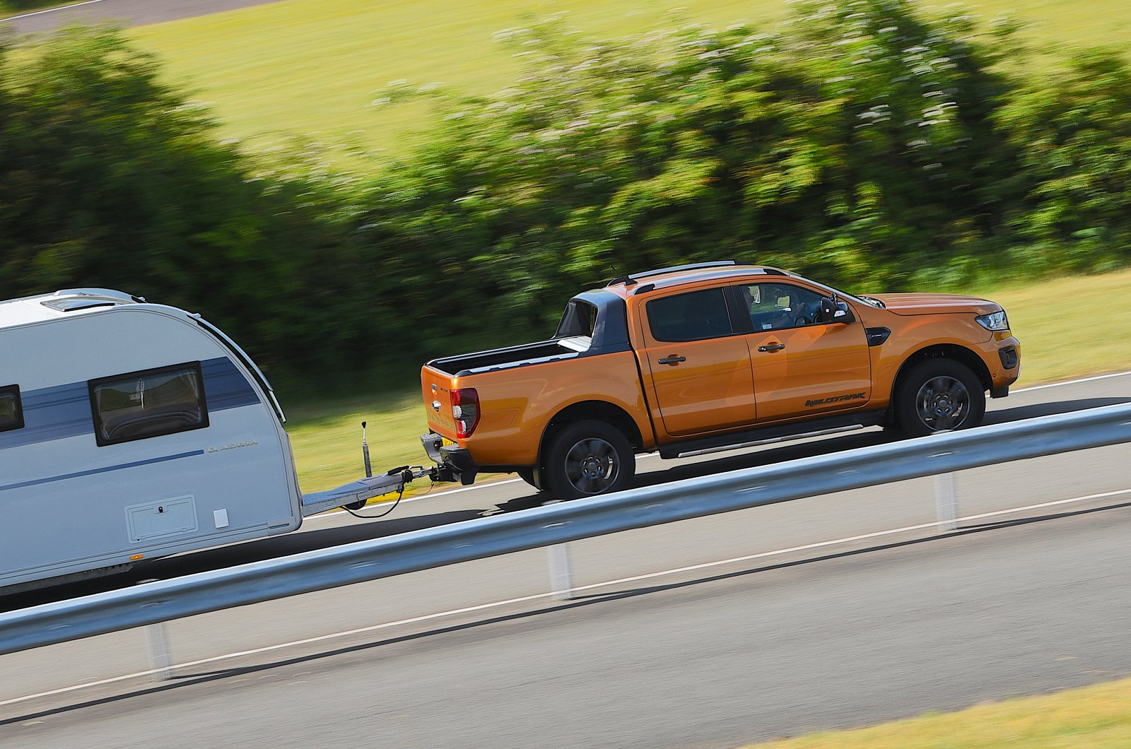 Ford Ranger towing a caravan - side