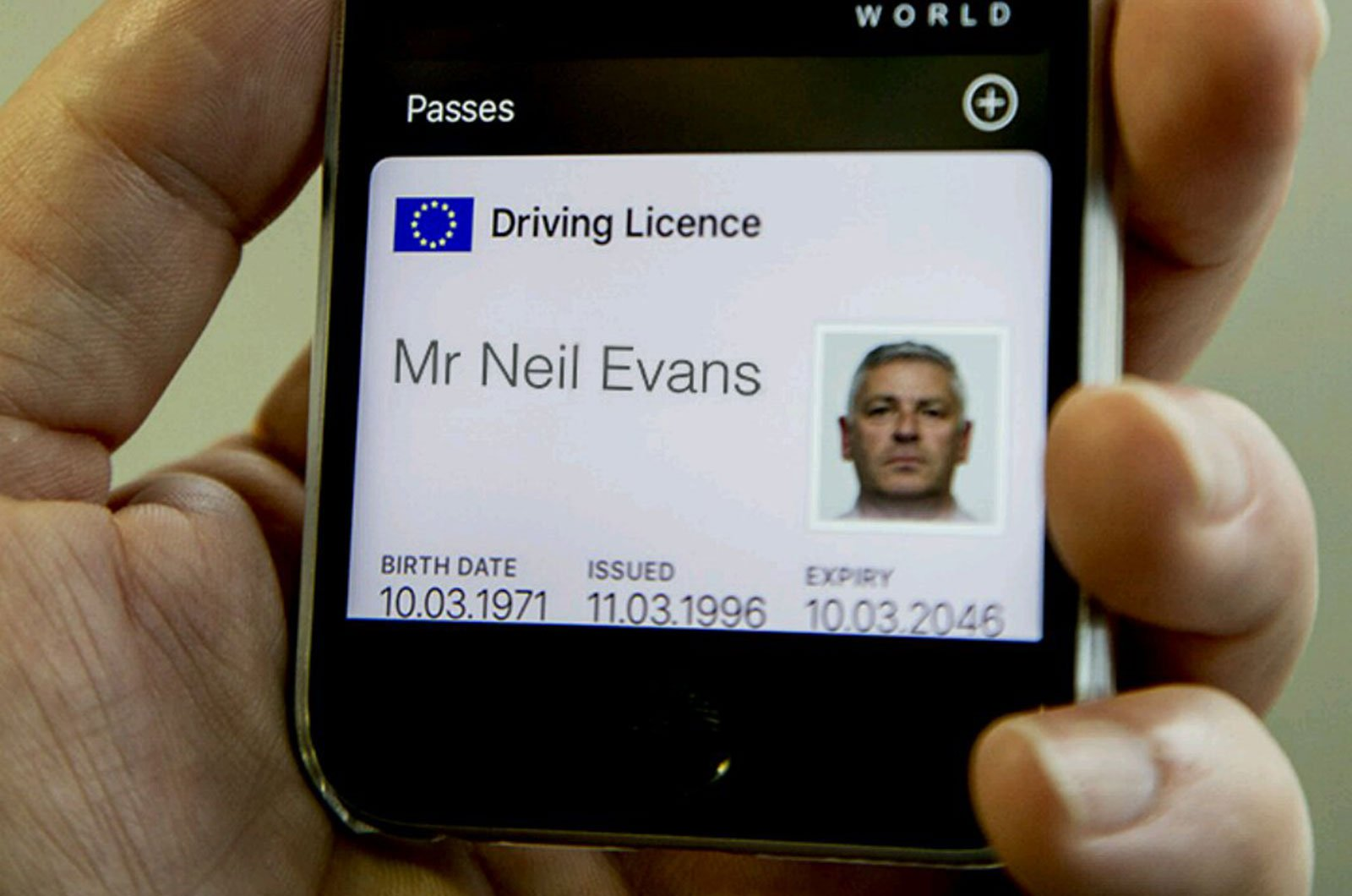 Mobile phone showing driving licence