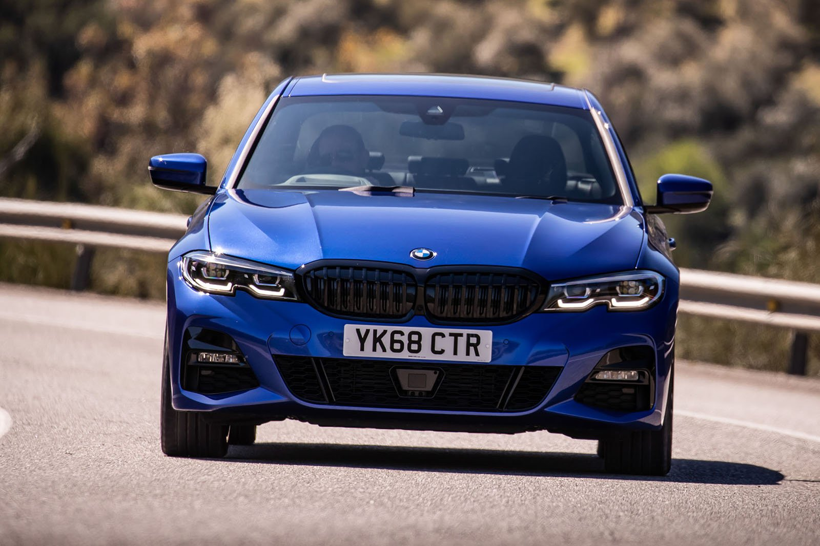 BMW 3 Series 2019 head on driving